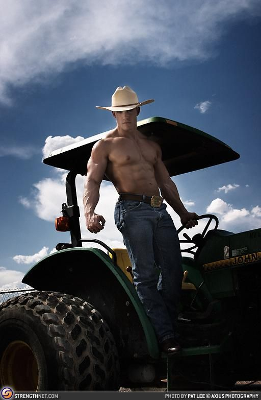 Naked man on tractor